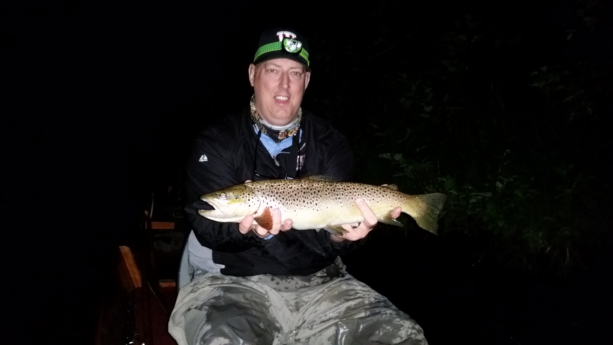 Tim Landeseld with a whopper of a brown caught on a bamboo rod his uncle made.